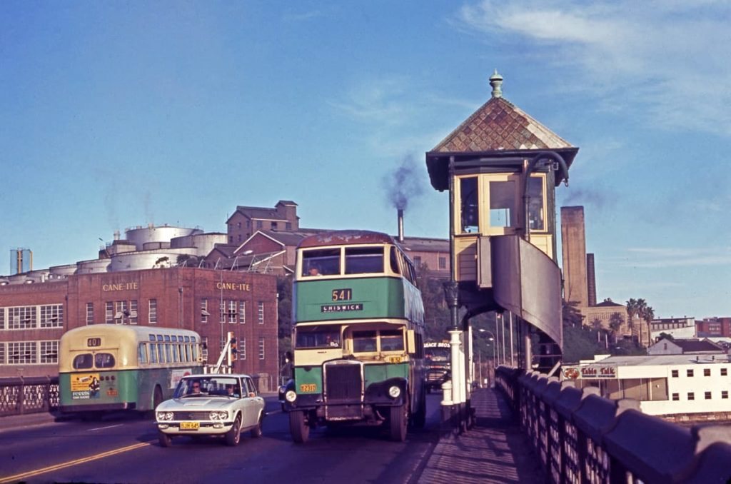 DGT Leyland OPD2-1 2310 with a body built by Comeng in 1949 on Route 541 Chiswick and AEC Regal IV 3033 Comeng in 1958 on Route 401 York Street City going the other way, coming off theGlebeIslandBridgetowards Victoria Road, White Bay. 24th February 1971. Photographer: John Ward. Image courtesy of City of Sydney Archives