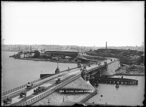 Glass plate negative of Sydney's Glebe Island swing bridge with Glebe Island abattoir in the background, 1903-1915. Image: MAAS
